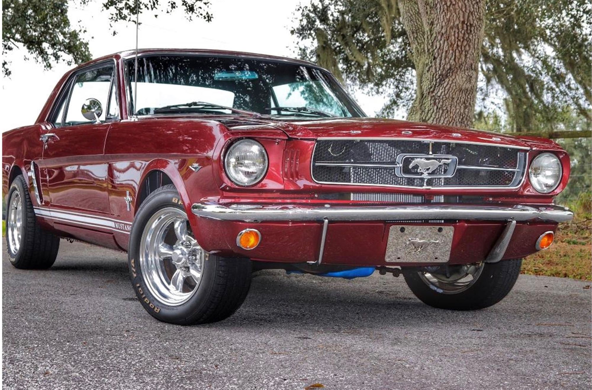 """<img src=""""1965-ford-mustang-front.jpg"""" alt=""""A 1965 Ford Mustang with aftermarket modifications could get antique tag revoked"""">"""