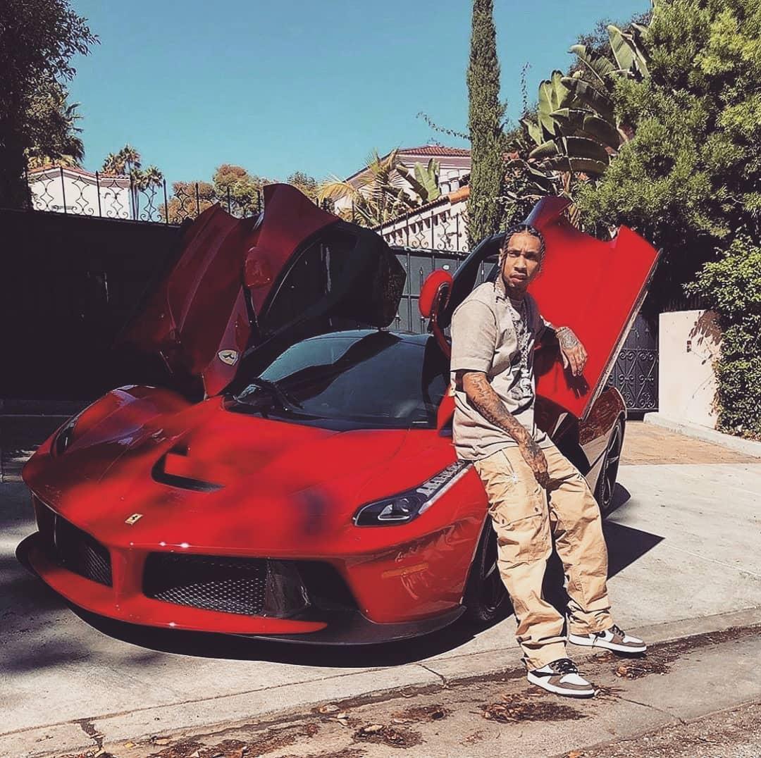 "<img src=""tyga-ferrari.jpg"" alt=""Rapper Tyga poses in front of one of a leased Ferrari"">"