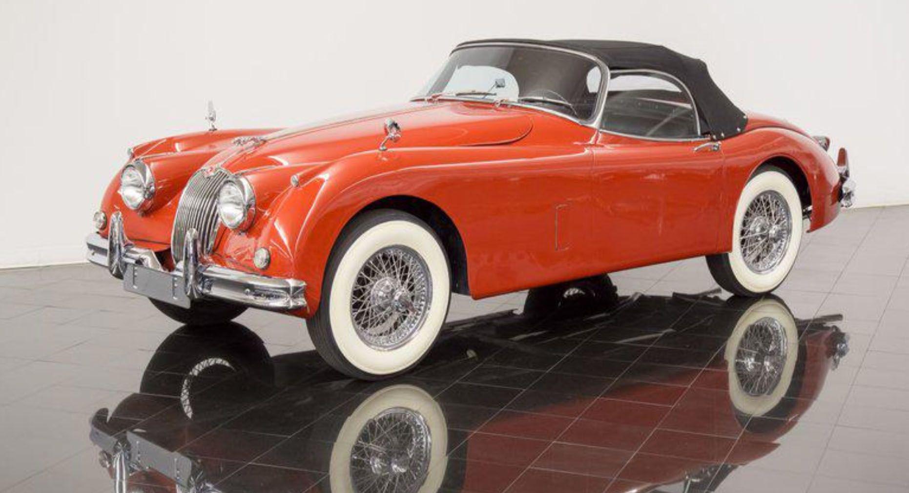 "<img src=""1959-jaguar-xk150.jpg"" alt=""A pristine 1959 Jaguar XK150 SE Roadster in Carmen Red"">"