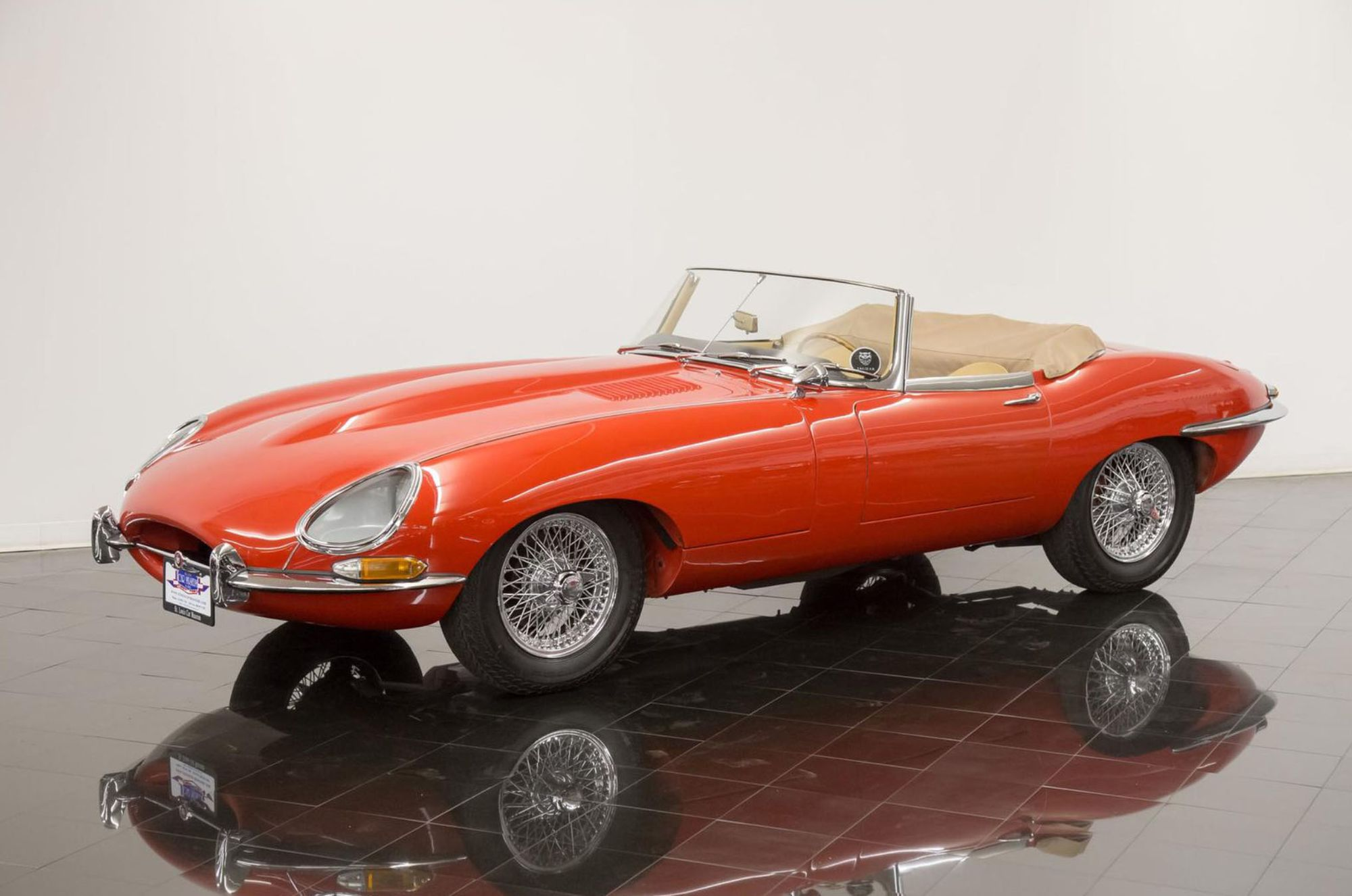 "<img src=""1964-jaguar-xke-e-type.jpg"" alt=""A stunning example of a 1964 Jaguar XKE E-Type Convertible"">"