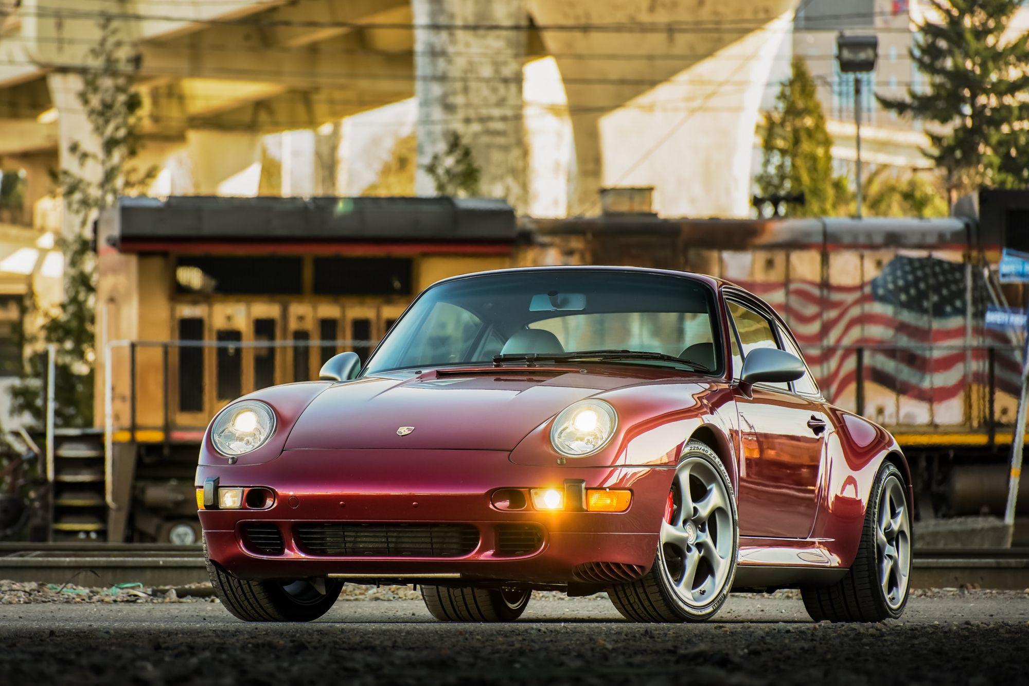 "<img src=""1997-porsche-911-carrera-4s.jpg"" alt=""The front of a 1997 Porsche 911 Carrera 4S in Arena Red Metallic"">"