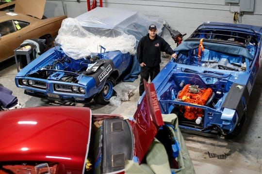 """<img src=""""dave-dudek.jpg"""" alt=""""Restoration expert Dave Dudek stands among some of his muscle car projects"""">"""