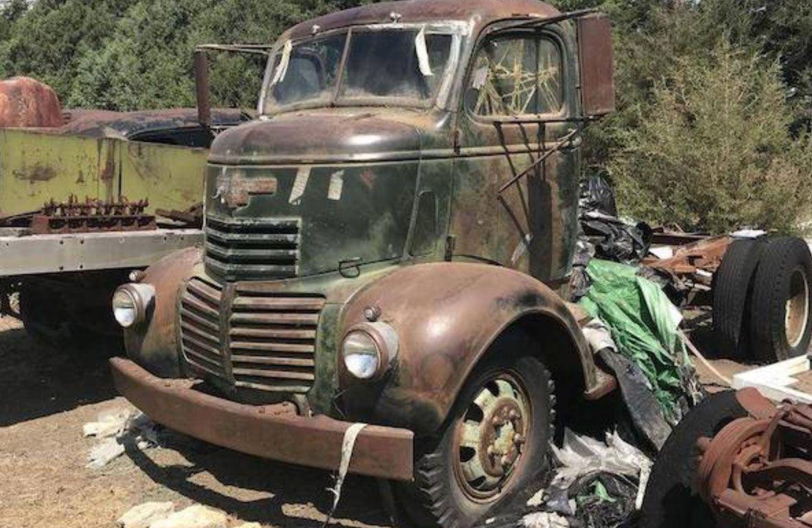 """<img src=""""scrapyard10.jpg"""" alt=""""An old rusty truck sits in a scrapyard"""">"""