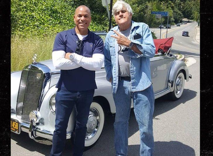 "<img src=""jay-leno-1.jpg"" alt=""Jay Leno helps stranded motorist Dwayne Henry with his 1953 Mercedes-Benz"">"
