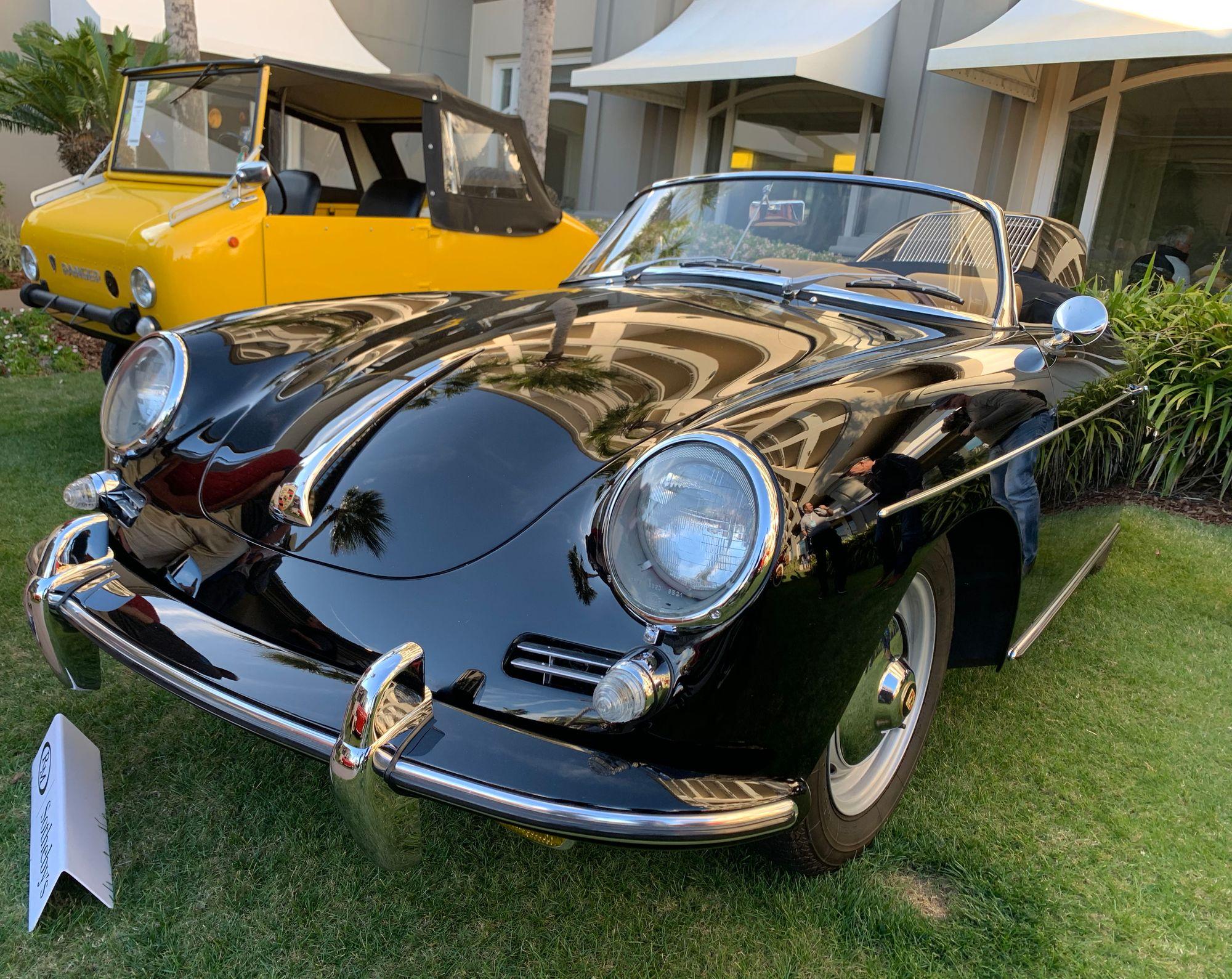 "<img src=""porsche9.jpg"" alt=""A vintage Porsche waiting to be auctioned at Amelia Island"">"