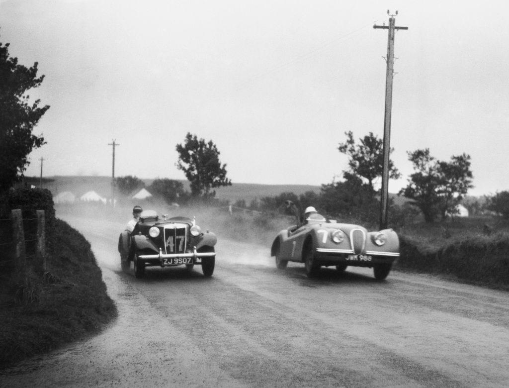 """<img src=""""stirling-jaguar.jpg"""" alt=""""Stirling Moss behind the wheel of a Jaguar XK120 at Dundrod in Northern Ireland"""">"""