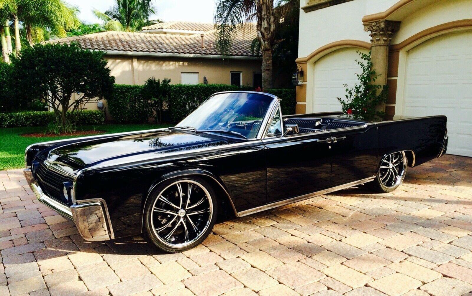 "<img src=""1963-lincoln-continental-convertible.jpeg"" alt=""A 1963 Lincoln Continental convertible"">"