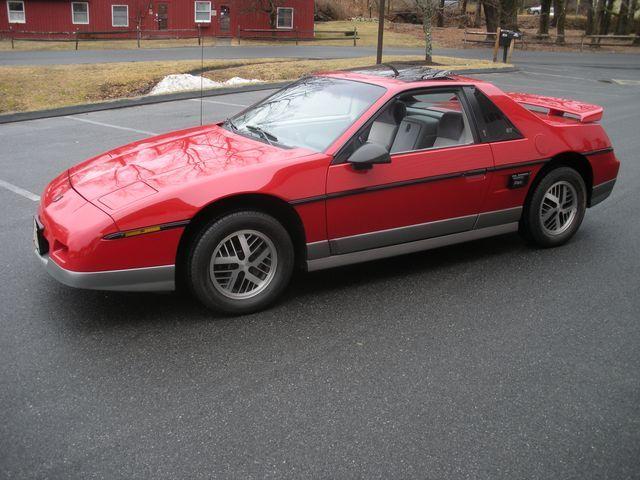 """<img src=""""1985-fiero.jpg"""" alt=""""1985 Pontiac Fiero"""">"""