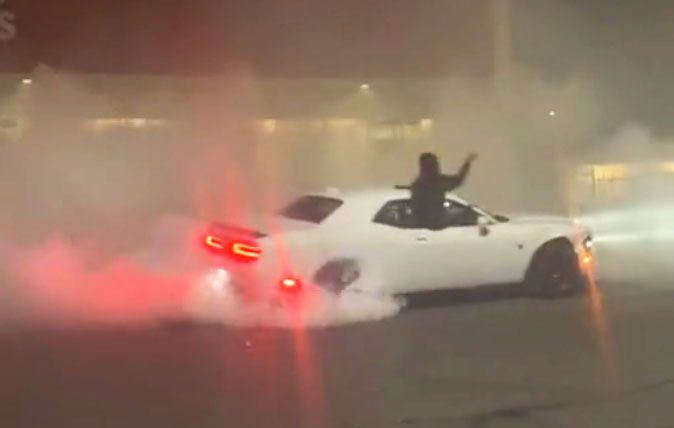 "<img src=""dodge-hellcat.jpg"" alt=""A Dodge Challenger Hellcat stolen by looters"">"