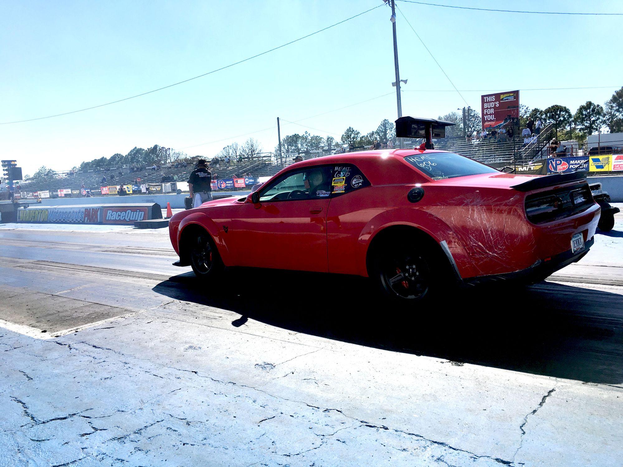 """<img src=""""dodge-challenger.jpg"""" alt=""""Dodge Challenger at the drag strip"""">"""
