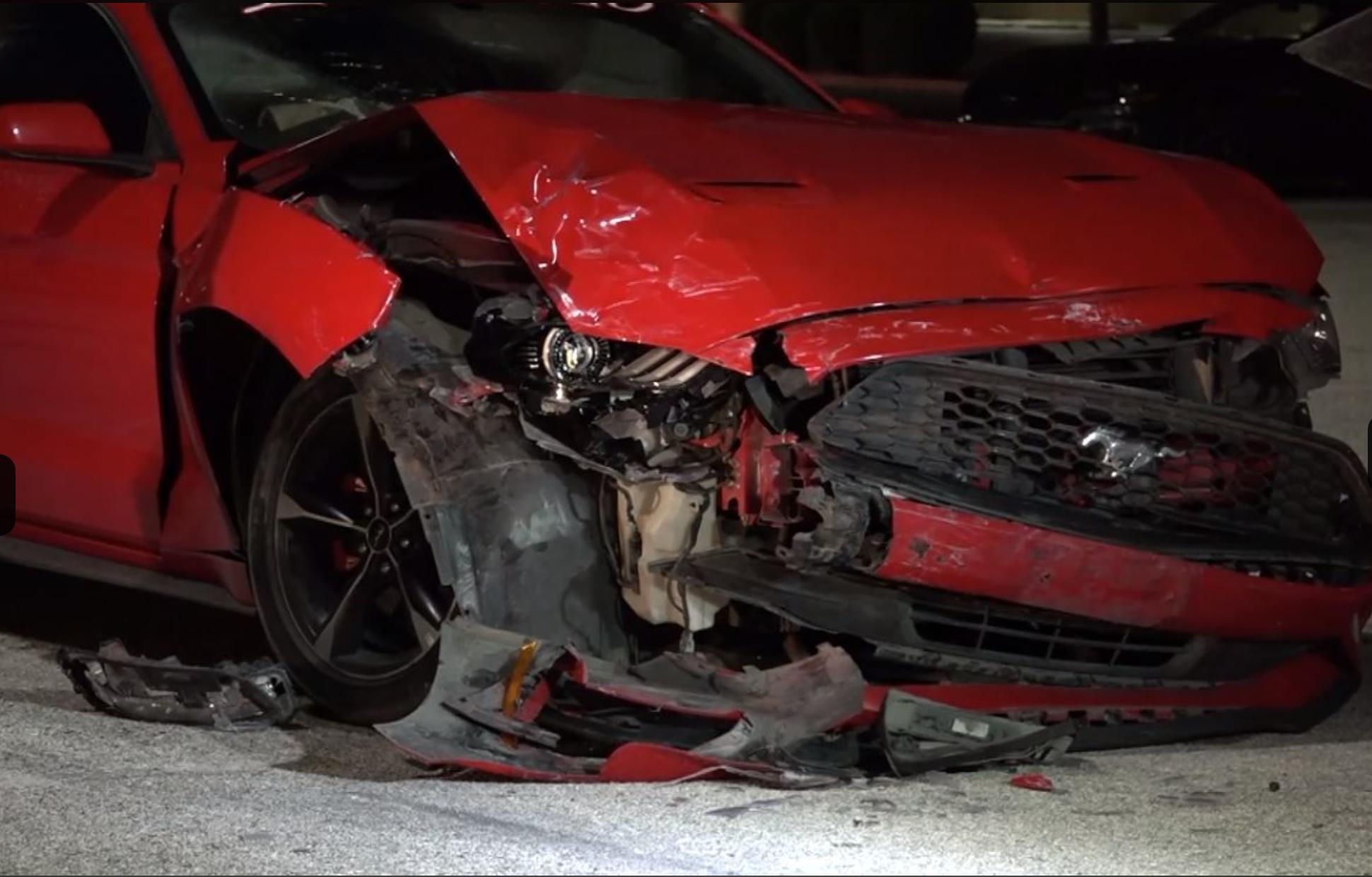 "<img src=""donuts-mustang-crash.png"" alt=""A crashed Mustang after parking lot donuts"">"