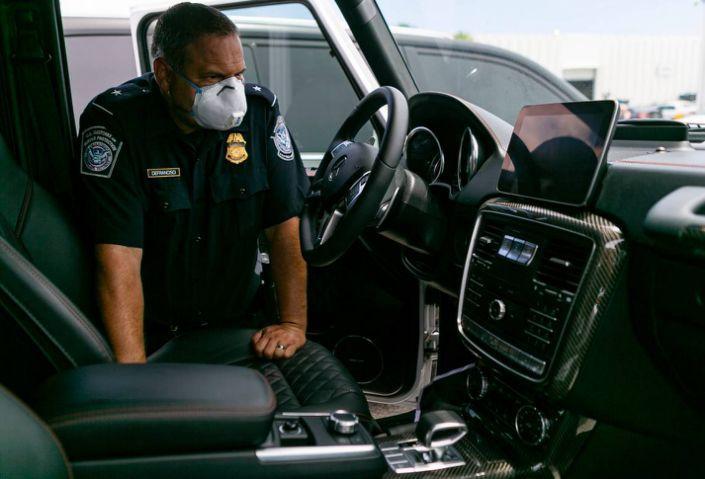 "<img src=""luxury-cars-2.jpg"" alt=""Seized luxury car in Port Everglades"">"