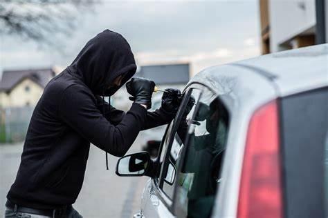 """<img src=""""steal-car.jpeg"""" alt=""""Car thief breaking into a car"""">"""