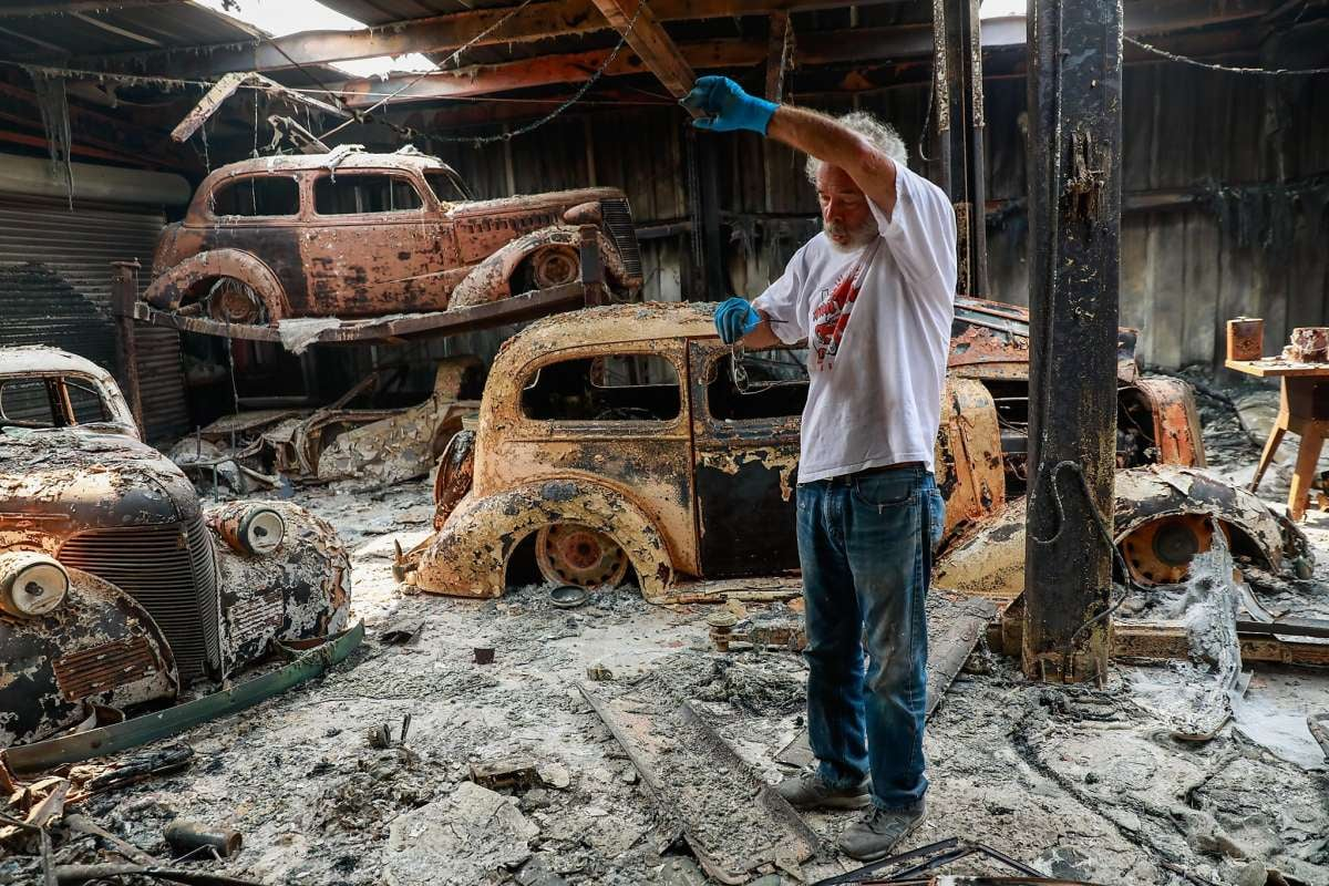 """<img src=""""ken-albers.jpg"""" alt=""""Ken Albers stands among his torched collection of restored classic Chevrolets"""">"""