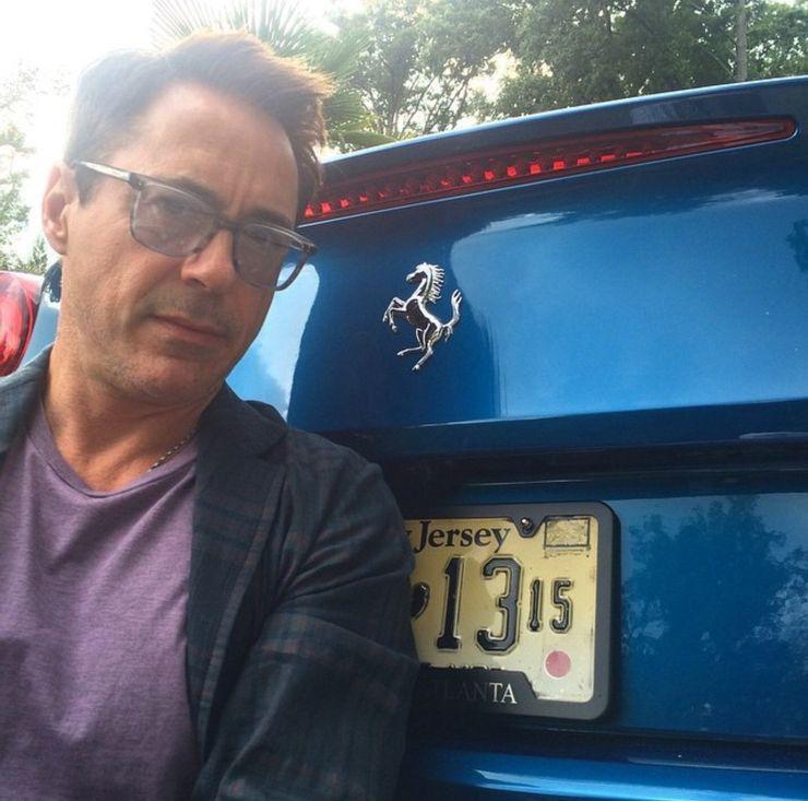 "<img src=""ironman.jpg"" alt=""Robert Downey, Jr., and his blue Ferrari California T"">"